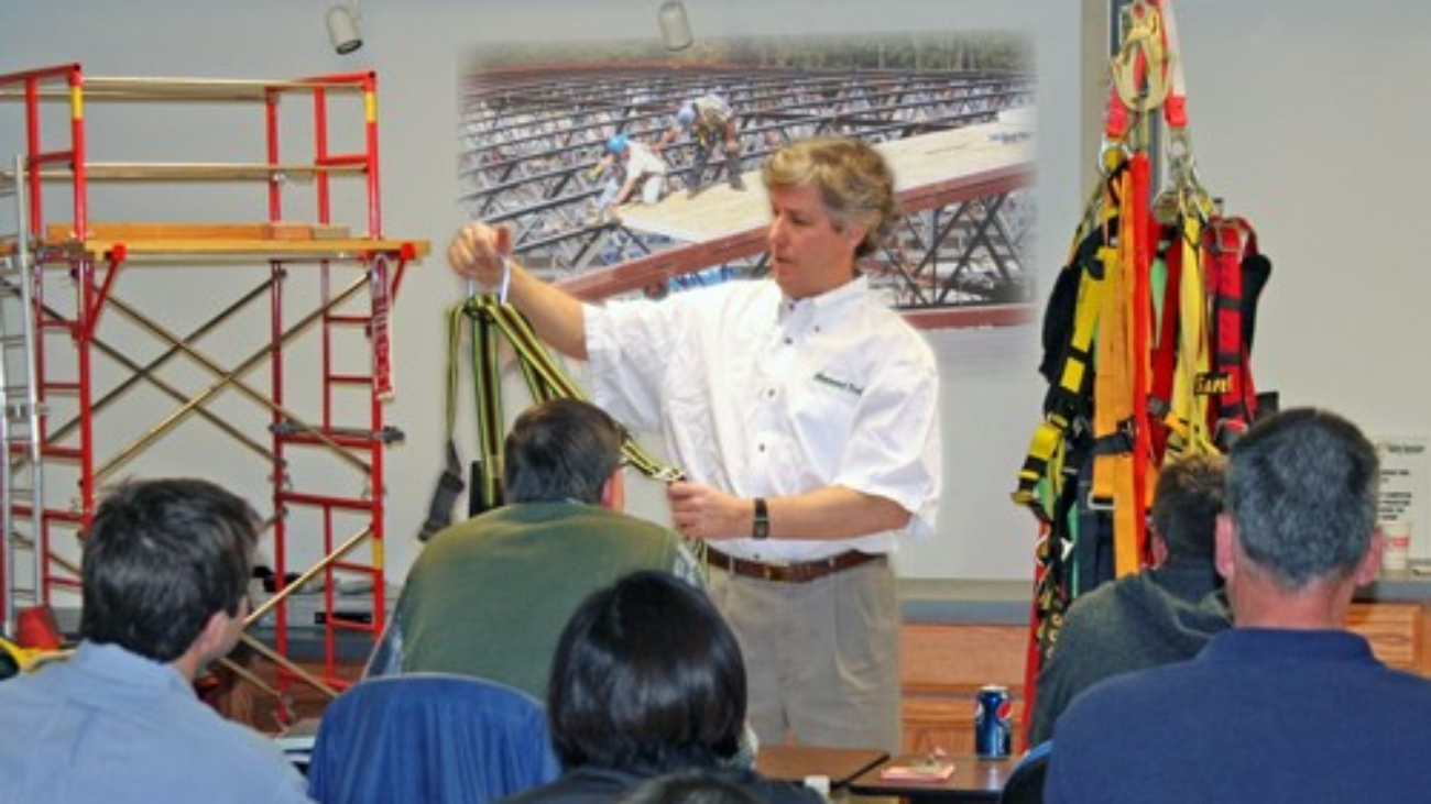 A person teaching an OSHA class in front of an audience