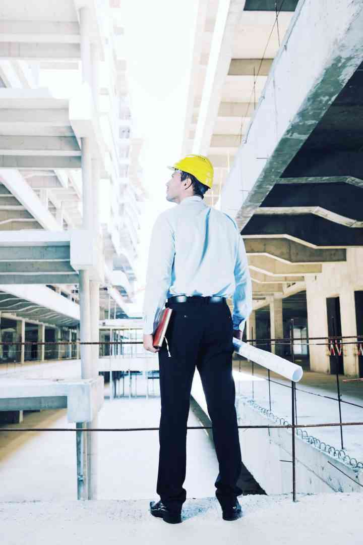 Man in a hardhat standing inside a warehouse