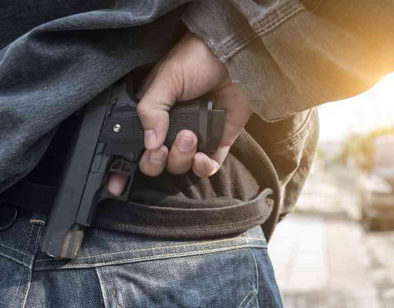 Active Shooter Holding Gun Behind Back