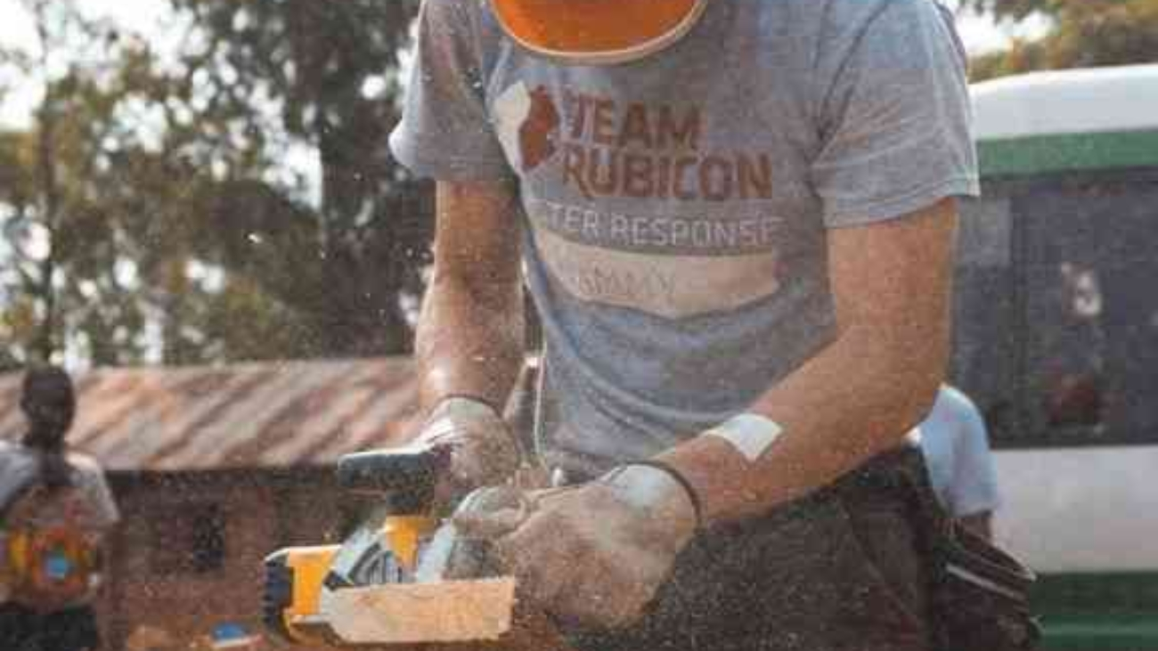 uas-man-with-hard-hat-and-chop-saw-min