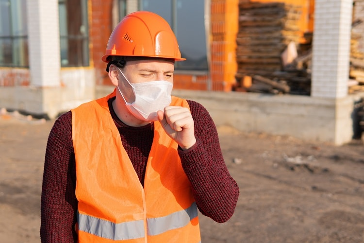 coughing construction worker-min