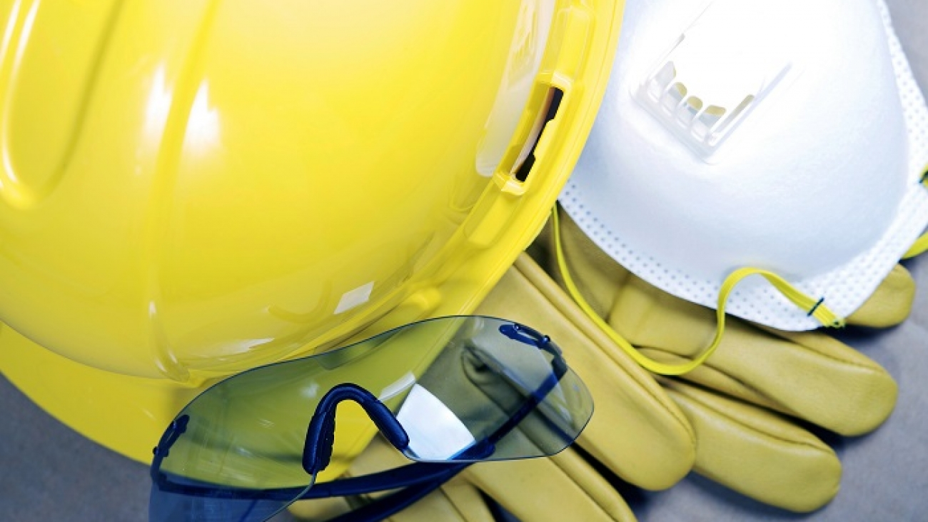Safety Protective Work Equipment. Yellow Helmet, Glasses, Gloves and Mask. Protection Gear Closeup.