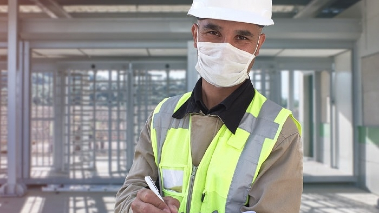 worker with mask and hardhat-min