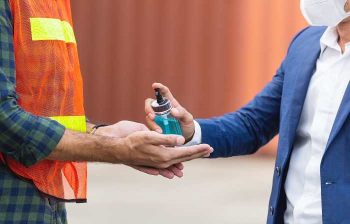 hand sanitizing on construction site