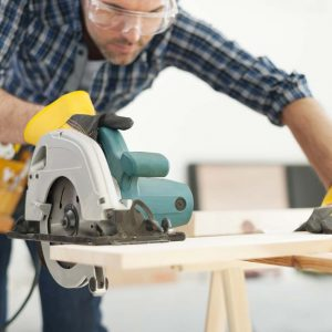 Worker safely using circular saw